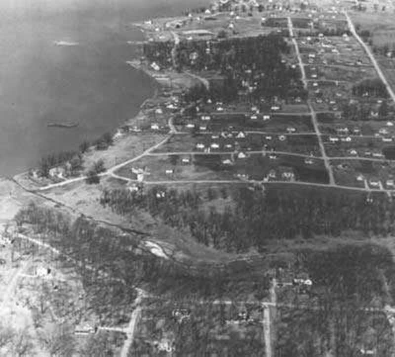 South East Shore of Wonder Lake, 1940. Wooded Shores Subdivision, orginally named Wicklein Bay Farms, is visible in the lower third of the photo, below the creek. Photo by C. Jacobson