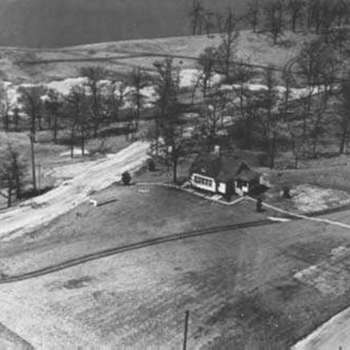 View from Lookout Tower, 1930's. The whole plan of forming the lake and developing the property evolved from this point. The building pictured was a real estate office. The lookout tower no longer exists today. Photo by C, Jacobson